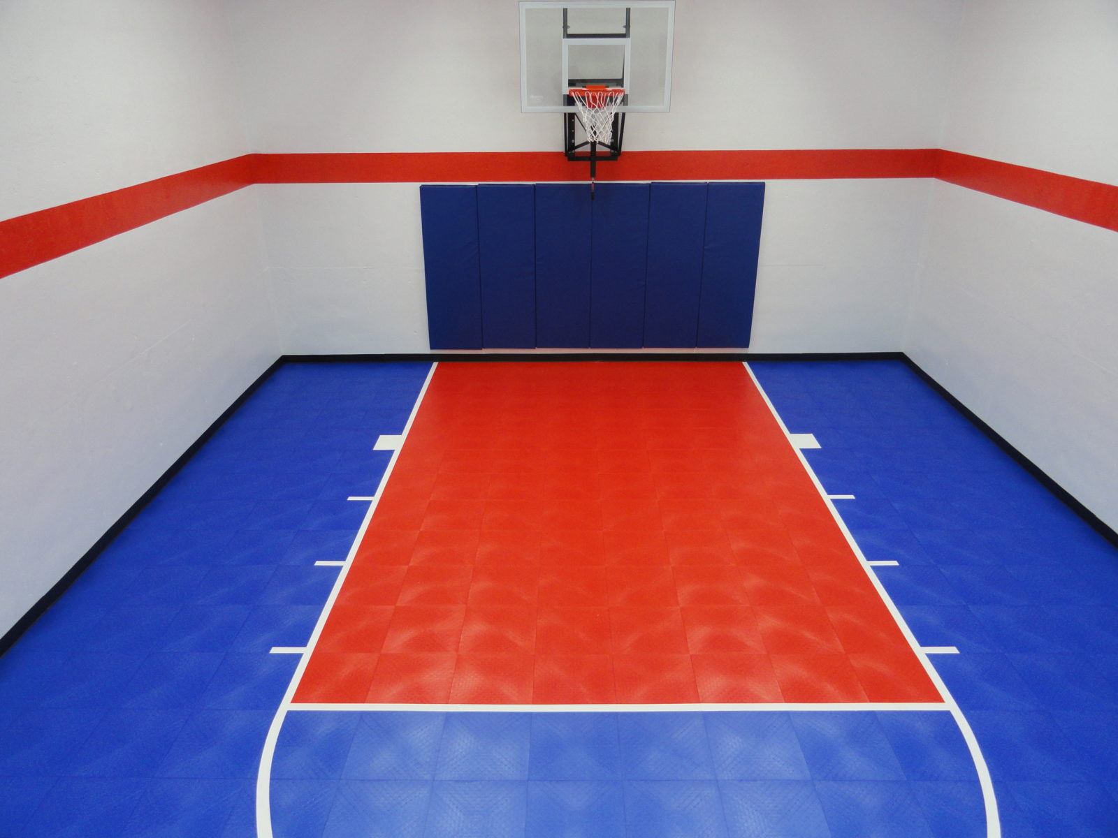 Home basketball courts and basketball flooring snapsports for Custom basketball court cost