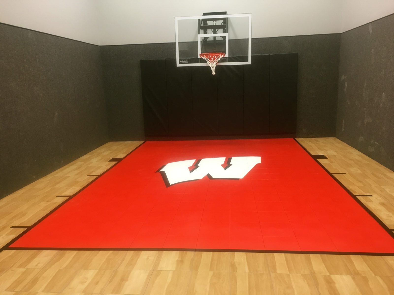 Indoor home gyms courts athletic surfaces millz house for Indoor basketball court design