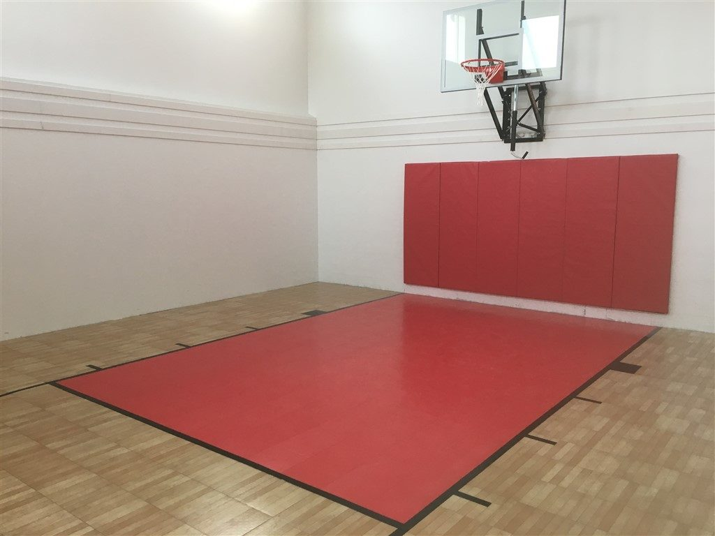 Indoor game court in Annandale with SnapSports Revolution Tuffshield Light Maple with red lane
