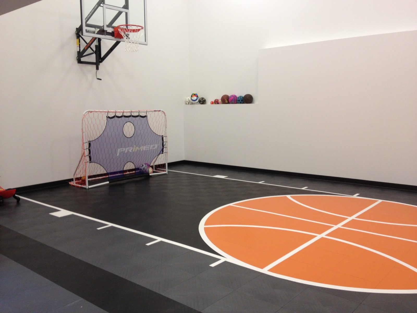 Indoor home gyms courts athletic surfaces millz house for Indoor basketball court flooring cost