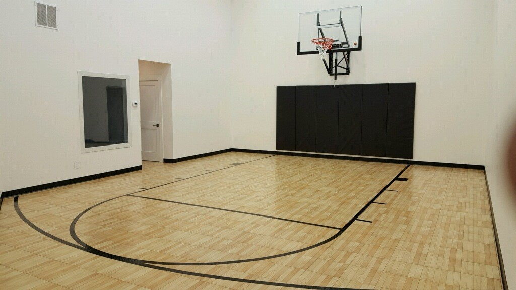 Indoor home gyms courts athletic surfaces millz house for Basketball court inside house