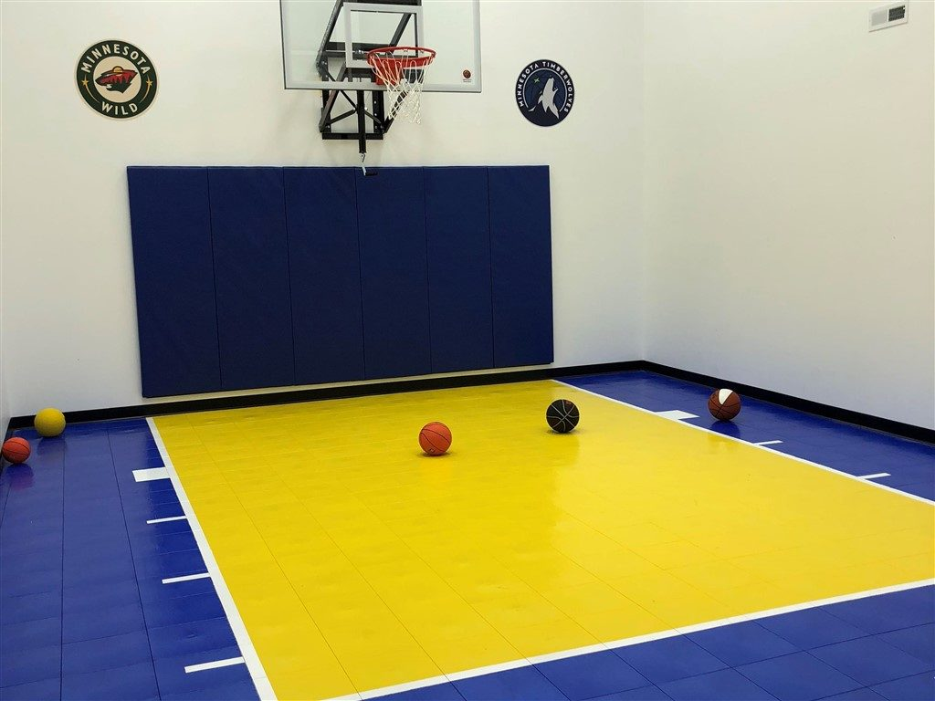 Twin Cities Spring Parade of Homes #30 game court featuring SnapSports athletic tiles installed by Millz House