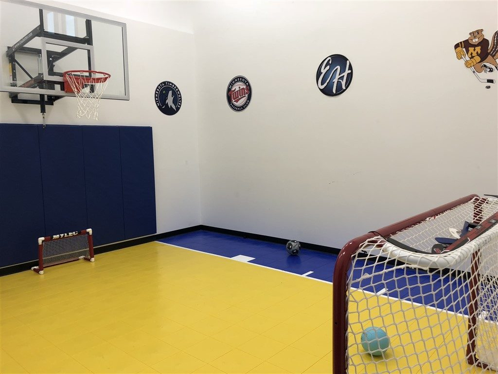 Twin Cities Spring Parade of Homes featuring Indoor Basketball Court installed by Millz House using SnapSports Bounceback athletic floor tiles
