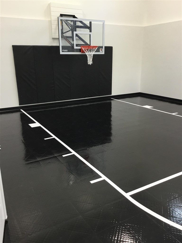 Twin Cities Spring Parade of Homes Indoor Basketball Court installed by Millz House featuring SnapSports Revolution athletic flooring