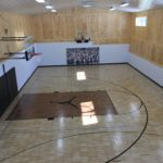 Indoor basketball and volleyball court installed by Millz House featuring SnapSports athletic flooring