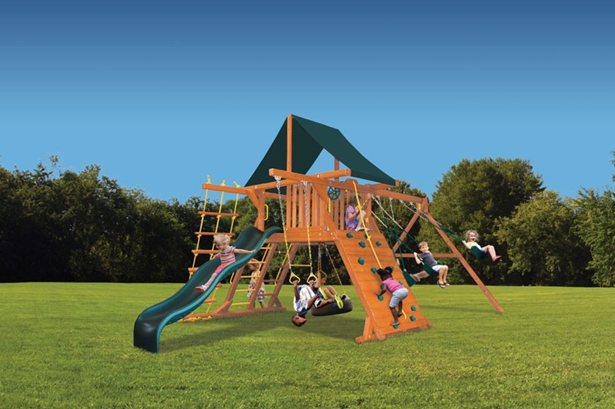 Original Playcenter outdoor playset with swing beam, slide, rockwall, trapeze bar and tire swing
