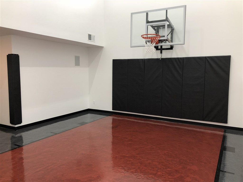 Twin Cities Spring Parade of Homes #197 indoor basketball court featuring epoxy floor coating installed by Millz House