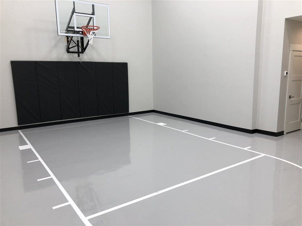 Twin Cities Spring Parade of Homes #33 indoor basketball court with epoxy floor coating installed by Millz House