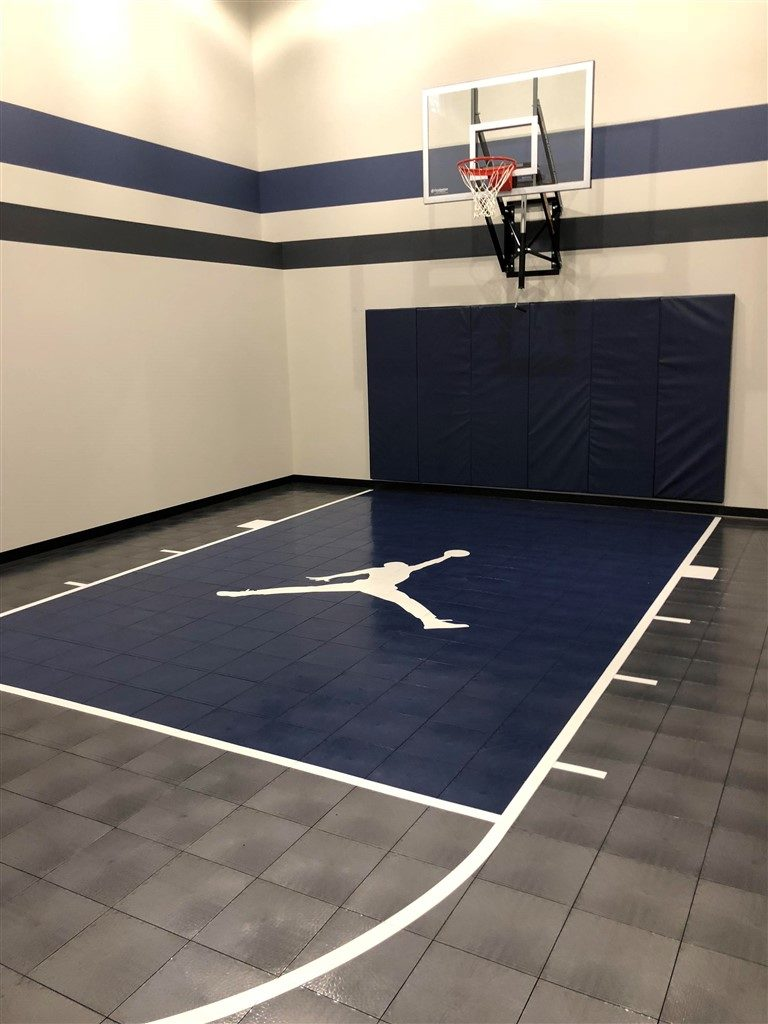 Twin Cities Spring Parade of Homes #36 indoor basketball court with SnapSports athletic tile flooring installed by Millz House
